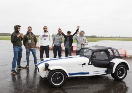 Automotive Engineering summer school - Students stand beside Caterham car